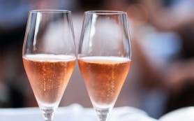 16018052 - two glasses of pink champagne for the couple.